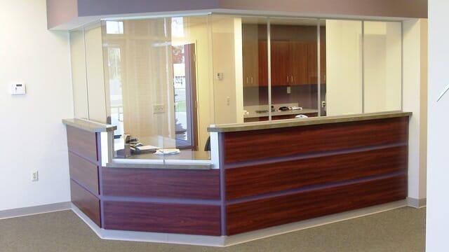 reception desk with sliding windows